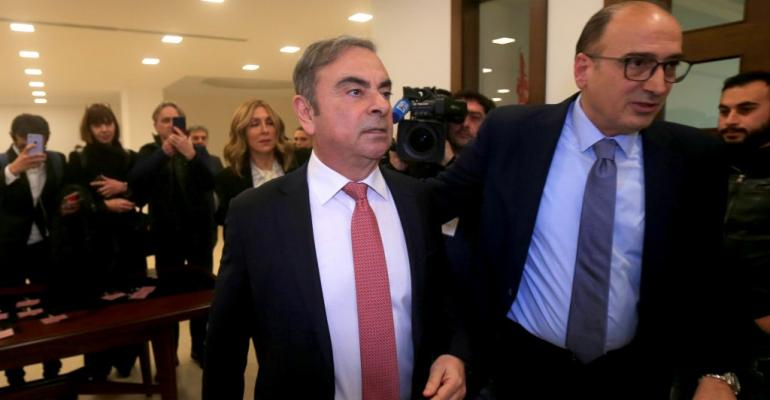 01 MAIN GettyImages-(Ghosn being escorted) LEBANON-JAPAN-FRANCE-GHOSN - Copy.jpg