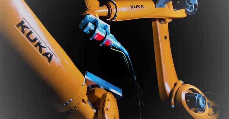 Robot-operated scanners examine vehicle from all angles.