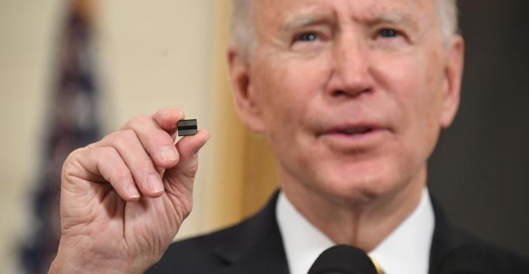Biden with microchip (Getty).jpg