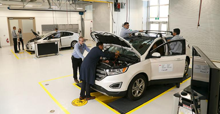 Engineers install instrumentation onto experimental vehicle at Canadian research facility.