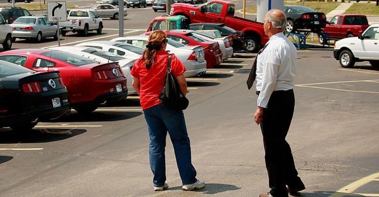 Car salesman with customer 2 (Getty).jpg