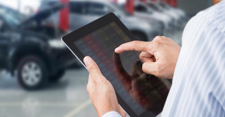 Car salesman with iPad (iStock).jpg