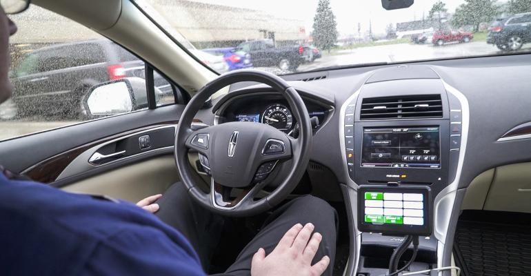 Dataspeed testing while behind the wheel of a self-driving car - Credit MEDC.jpg