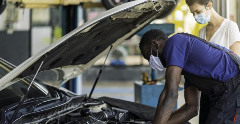Dealer - mechanic with customer.jpg