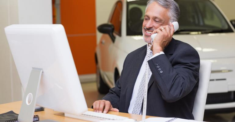Dealer - on phone at car dealership.jpg