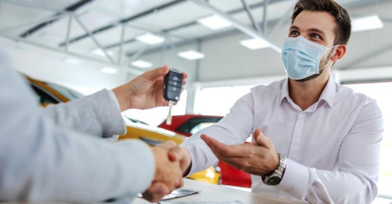 Dealer-masked customer.jpg