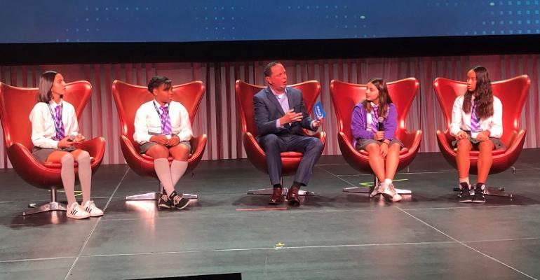 Local seventh graders share AutoMobility LA stage with SBD's Hannah.