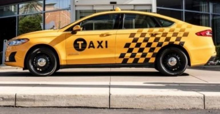 Automaker says Fusion Hybrid Taxi expected to deliver 38 mpg combined.