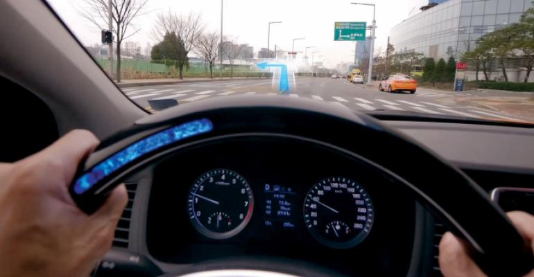 Hyundai steering wheel's LEDs give the hearing-impaired navigational information.