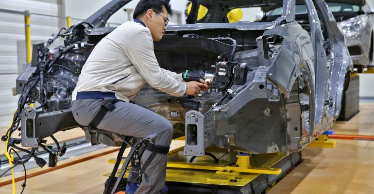 Hyundai's Chairless Exoskeleton helps maintain worker's sitting position.