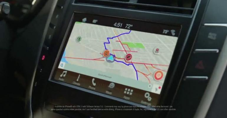 Top-ranked ad for Lincoln MKC highlights Waze navigation feature.
