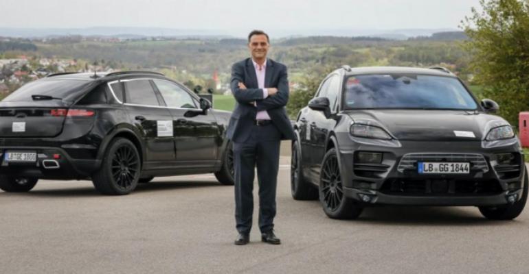 Porsche_Michael_Steiner_with Macan_EV_prototypes_0.jpg