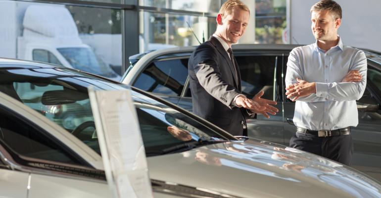 Salesman with customer (Adobe Stock).jpeg