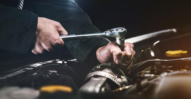 Mechanic working on engine.