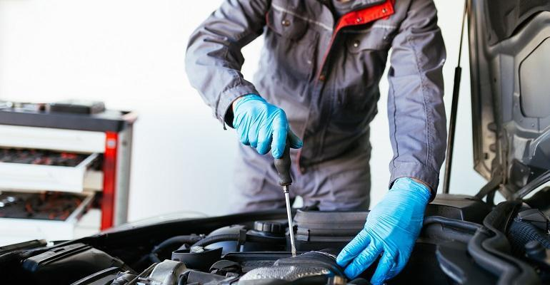 auto mechanic with gloves (Getty).jpg