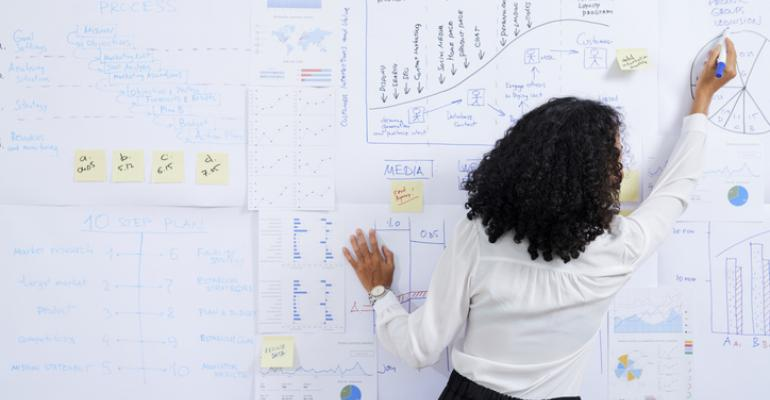 business strategy woman writing on board.jpg