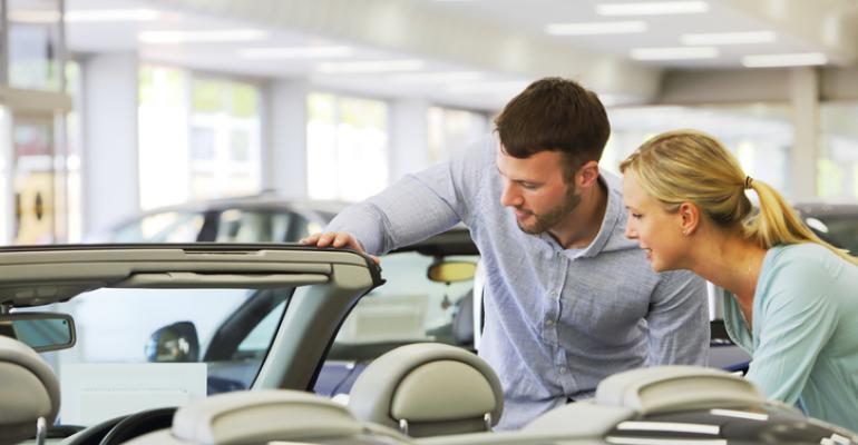 couple looking at car at dealership .jpg