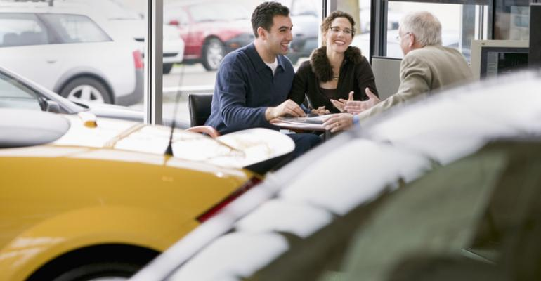 customers at desk with salesman.jpg