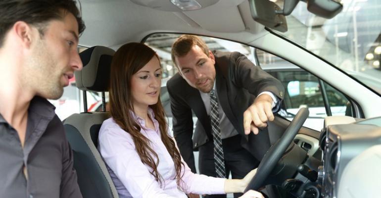 dealership salesperson showing couple.jpg