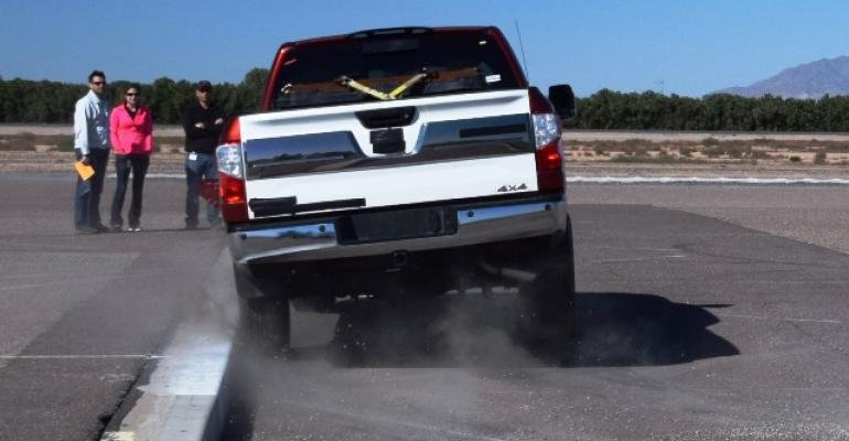 Titan XD slams sideways into tall curb in durability test at Nissan39s Arizona proving grounds
