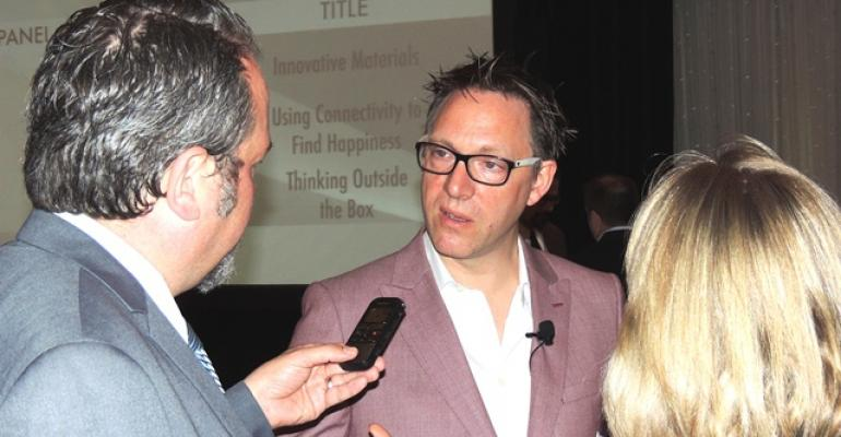 Ford39s Amko Leenarts speaks with WardsAuto editor Byron Pope after keynote speech