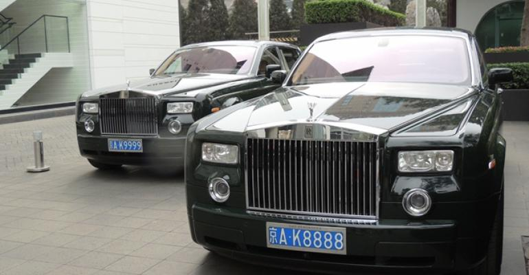 Rolls Royces ready to transport guests at Peninsula Hotel