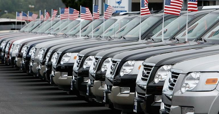 row of cars with american flags.jpg