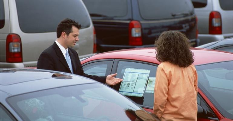 salesman and customer at used car lot.jpg