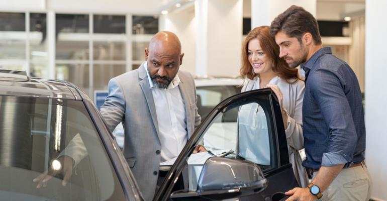 salesman with two customers .jpg