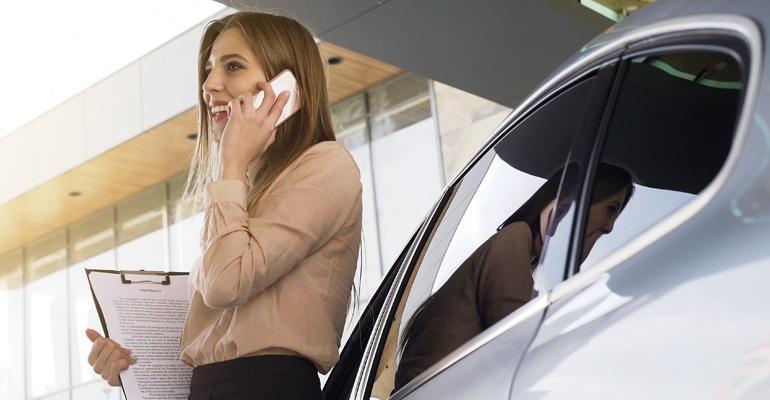 saleswoman on phone and sales floor.jpg