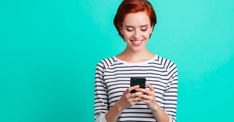 smiling woman on smart phone.jpg