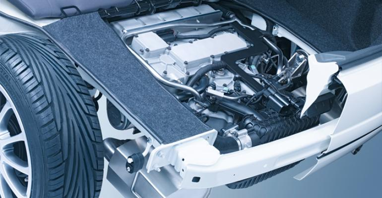 KSPGrsquos EREV module consisting of V2 engine and two generators fits in tidy package under trunk of Fiat 500 concept