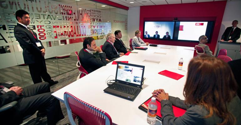 Customers connect with DuPont team in Geneva by videoconference to discuss developing lightweight airinduction systems