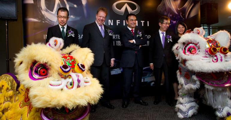 Nissan CEO Carlos Ghosn center and Executive Vice President Andy Palmer left of Ghosn at Infiniti Hong Kong headquarters opening