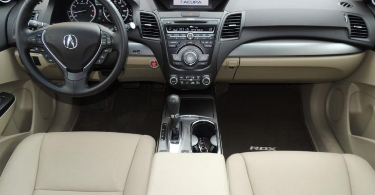 rsquo13 Acura RDX dark brown carpeting complements beige interior