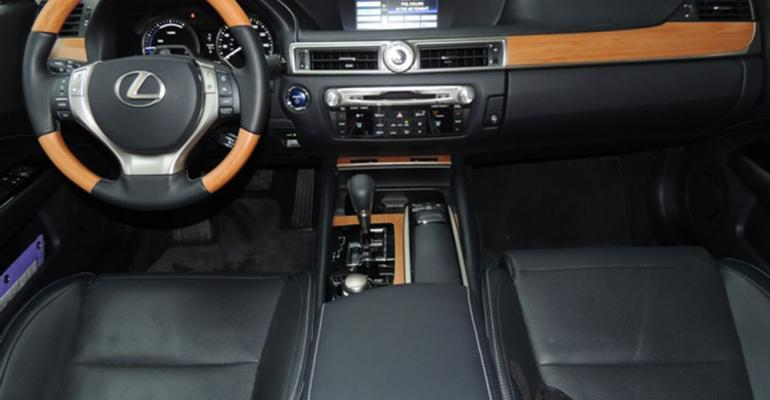 Interior blends naturallooking wood trim with plush leather and quality plastics
