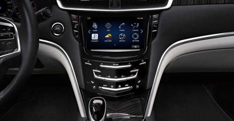 Cadillac racks up points for bold design daring use of color and trim materials