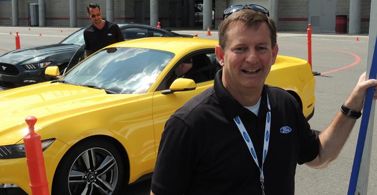 Mustang Vehicle Engineering Manager Tom Barnes talks to journalists in Charlotte NC during brief rides in allnew pony car