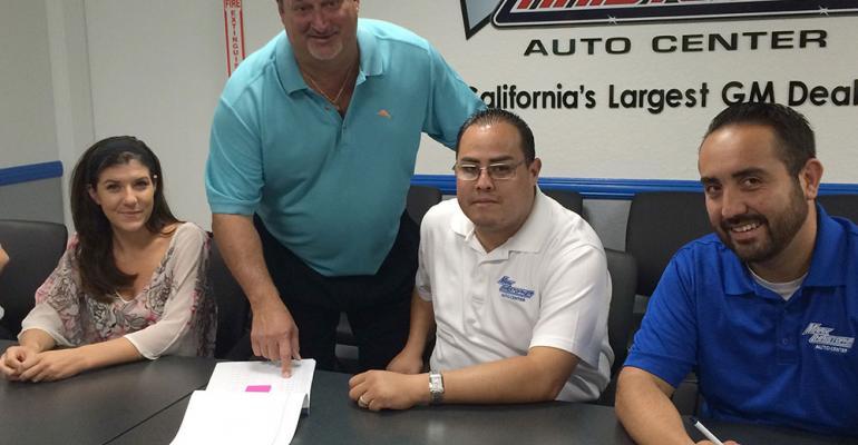 Leggio standing at sales meeting with staffers from left Ashley Gordon Nevin Cordero and Joe Gonzalez