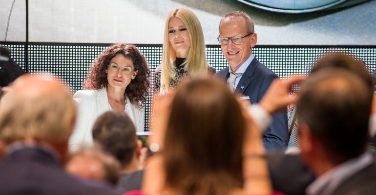Mueller left with celebrity brand ambassador Schiffer and Opel CEO Neumann