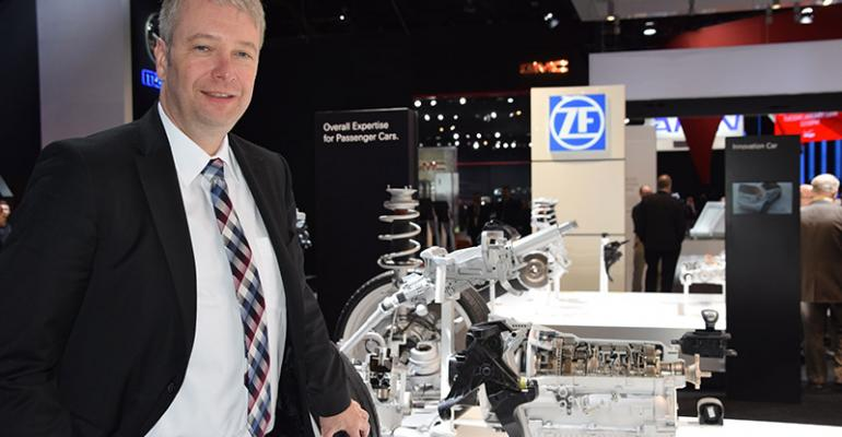 ZF CEO Stefan Sommer at NAIAS with companyrsquos new 8speed plugin hybrid transmission