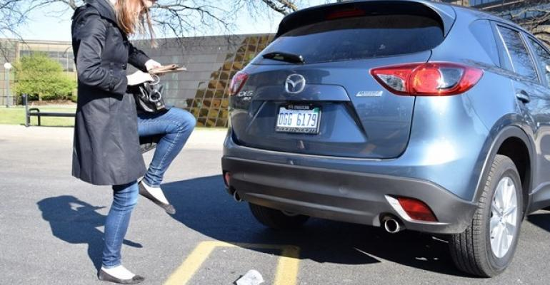 Editor Schweinsberg recreates her onelegged hop to find keyfob CX5 demo vehicle only ie tailgate release is in middle