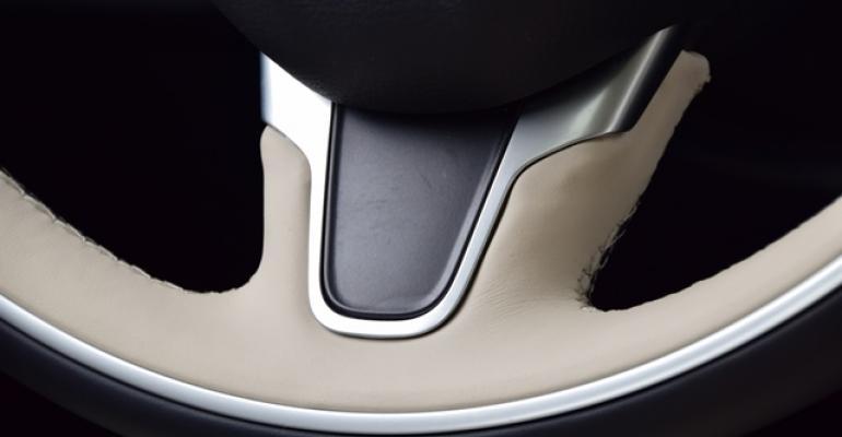 Twotone IndigoLinen leatherwrapped steering wheel handstitched