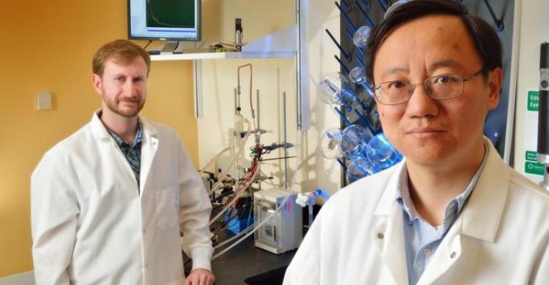 Virginia Tech professor Percival Zhang right with doctoral graduate Joe Rollin