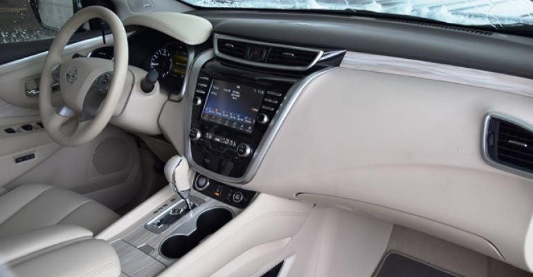 Nissan Murano interior punctuated by smooth flowing lines extending from IP to center console