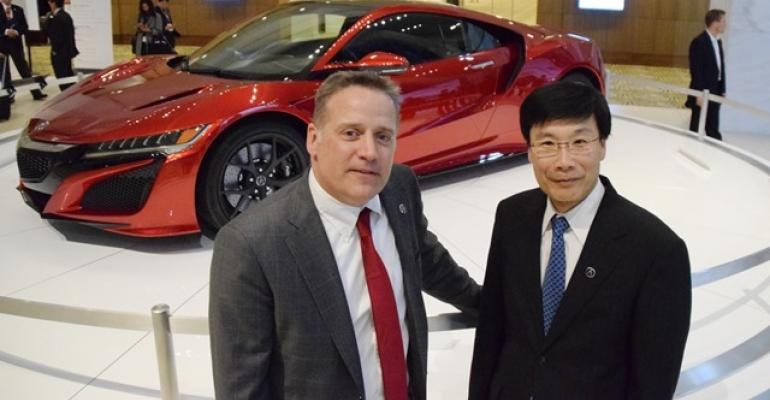 Honda chief engineers Ted Klaus and Yashuhide Sakamoto with Acura NSX