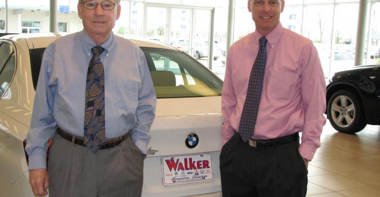 Searcy right and Forest Walker III whose grandfather began selling cars in 1919