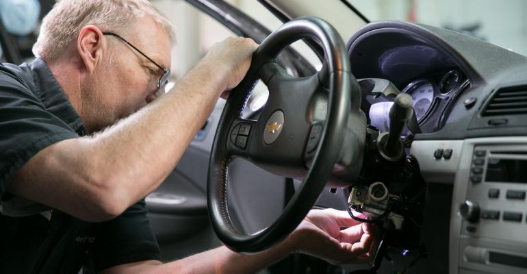 Dealership auto technician replaces ignition system on recalled Chevrolet