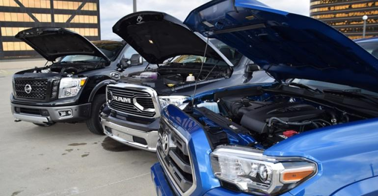 Engines in new Nissan Titan XD from left Ram 1500 EcoDiesel and Toyota Tacoma being tested by WardsAuto editors