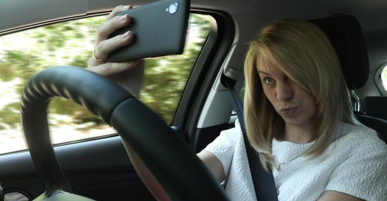 Selfies more costly for UK drivers next year